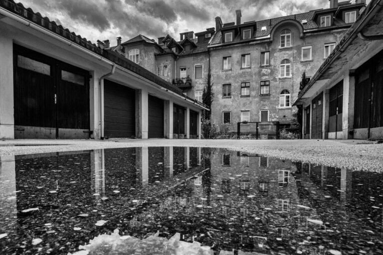 Old socialist apartment building with reflection, Ljubljana. Photo by Iztok Boncina.
